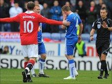 Wayne Rooney of Man Utd and Wigan's James McCarthy