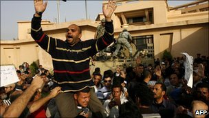 Egyptian protesters in front of a state security building on the outskirts of Cairo 