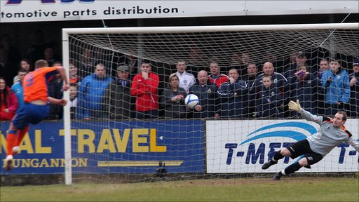 Peter Thompson fires in his second from the penalty spot against Dungannon