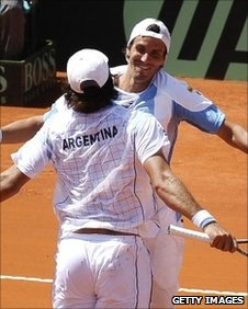 Argentina's Juan Ignacio Chela (R) and Eduardo Schwank celebrate after defeating Romania's Victor Hanescu and Horia Tecau in their Davis Cup first round doubles match