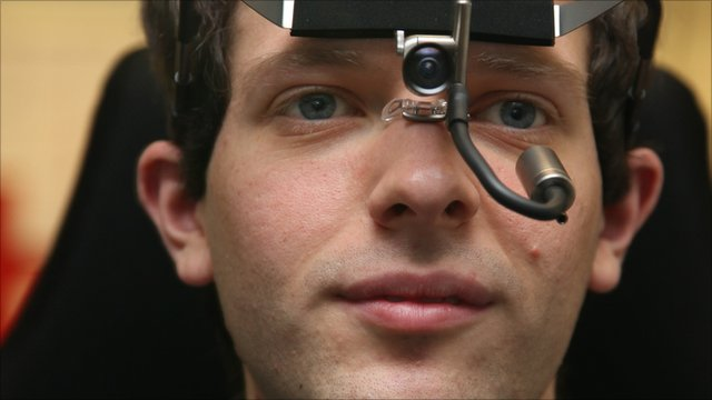 A man wearing an eye-tracking camera