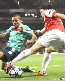 Samir Nasri turns away from Dani Alves