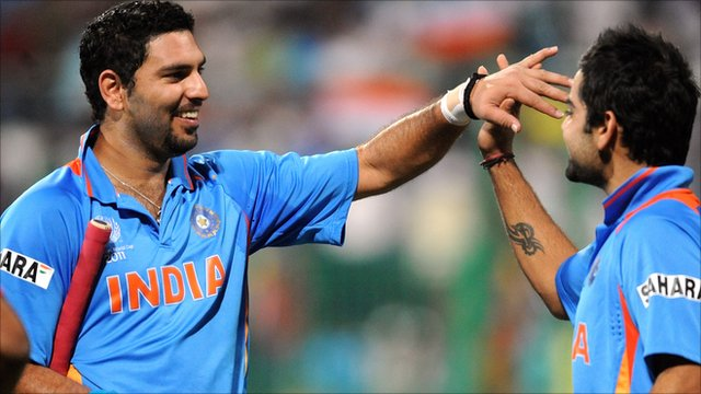 India cricketer Yuvraj Singh (L) celebrates the victory with Virat Kohli