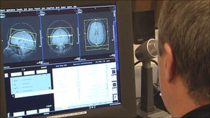 Zoran Josipovic looking at brain scans on a computer