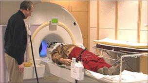 """Zoran Josipovic prepares a Buddhist monk for a brain scan in an fMRI"" machine"