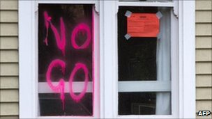 'No Go' is written on the window of a condemned home in Christchurch NZ 6 March 2011