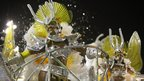 Dancers perform on a Sao Clemente samba school float during a parade at the Sambadrome in Rio de Janeiro
