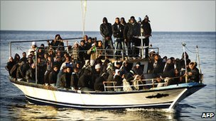 Would-be immigrants arrive by boat from north Africa