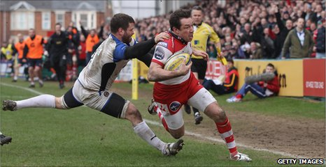 Tom Voyce escapes the clutches of Luke Watson for Gloucester's bonus-point try