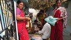 Women buying saris