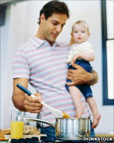 Generic picture of a father cooking with his child