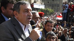 Egyptian Prime Minister Essam Sharaf (left) addresses demonstrators in Cairo's Tahrir Square, 4 March 2011