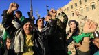 Supporters of Libya's leader Muammar Gaddafi chant slogans in central Tripoli (6 March)
