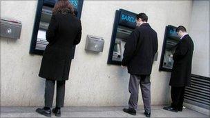 People at cash machines