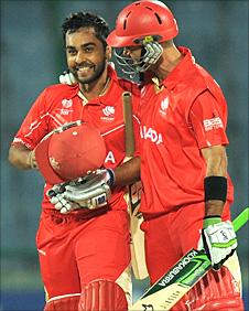 Ashish Bagai celebrates victory with John Davison