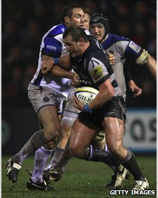 Butch James attempts to tackle Carl Fearns