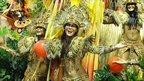 Revellers of Grande Rio parade in the Sambadrome