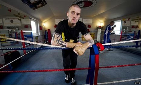 Ricky Burns relaxes during training