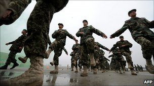 Afghan National Army (ANA) non commissioned officers (NCO) march during a graduation ceremony in Kabul on February 3, 2011.