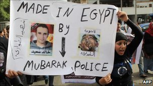 Egyptian activists protest against torture in police stations in Cairo, June 2010