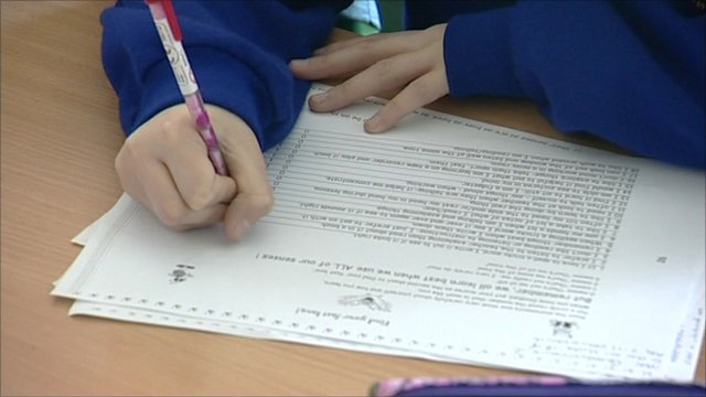 Child writing with a pencil