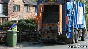 Waste disposal van, bin and a man