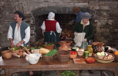People preparing for medieval banquet