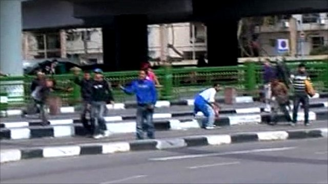 People throwing stones in Cairo