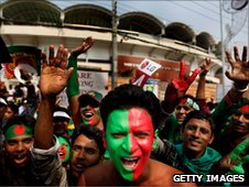 bangladesh fans with faces painted in the national colours of red and green