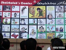 Cartoons on street in Benghazi