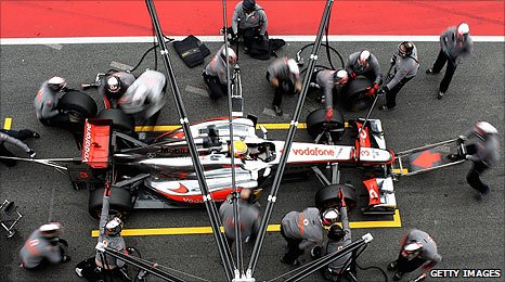 McLaren mechanics work on the new MP4-26