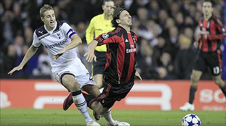 Tottenham centre-back Michael Dawson (left) foils AC Milan striker Zlatan Ibrahimovic
