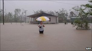 "March 8, 2011 woman in floodwater during heavy rain in Cardwell, in the far north of Australia""s Queensland."