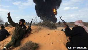 Libyan rebels take positions in Ras Lanuf on 9 March 2011.