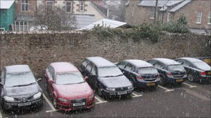 Snow on cars in Inverness
