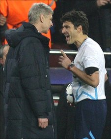 Arsene Wenger (left) and referee Massimo Busacca (right)