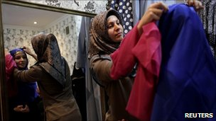 A woman tries on Islamic clothing at a shop in Grozny, Chechnya, 9 March 2011