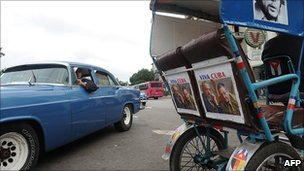 Car and bicycle-taxi in Havana