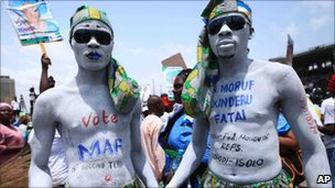 Men painted with the colours of Action Congress of Nigeria, during a rally at Tafawa Balewa Square, Lagos, Nigeria. (5 March 2011).