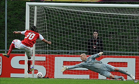 Liverpool keeper Pepe Reina is beaten by Braga midfielder Alan's penalty