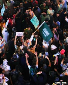 Protesters brandish placards in Qatif, 10 March 2011
