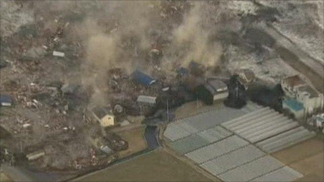 Wave engulfs land in Japan