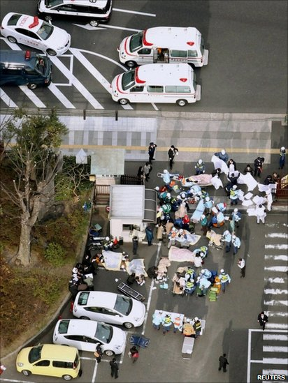 Injured people are attended to by emergency personnel after the earthquake in downtown Tokyo