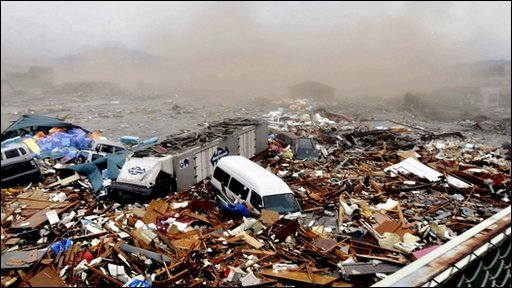 Cars and debris swept away by tsunami tidal waves in Kesennuma in Miyagi Prefecture, in northern Japan, after strong earthquakes hit the area