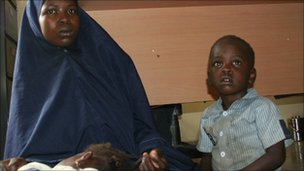 Yakaka, 20, and her two children, in police custody