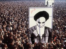 January 1979, Iranian protesters hold a up a poster of Ayatollah Khomeini