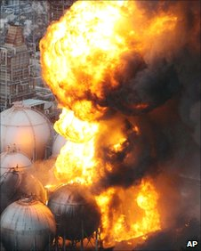 A fire burns at an oil refinery after the enormous earthquake