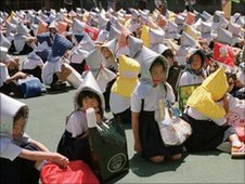 Wearing disaster prevention hoods schoolchildren take part in a drill in 1999 to commemorate victims of the Kanto earthquake