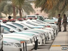 Saudi police cars are parked and policemen stand guard in front of 'Al-rajhi mosque' in central Riyadh on March 11, 2011