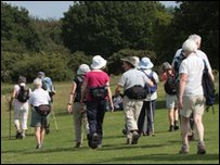 Walking group crosses field
